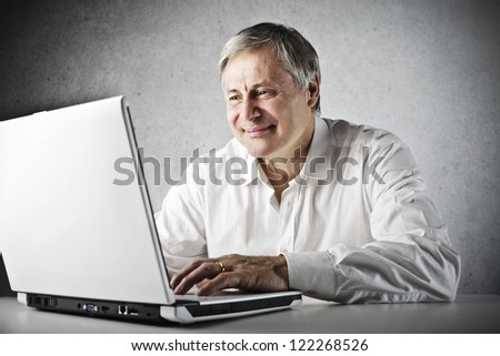 Old man using a laptop computer