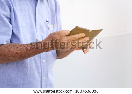 Old man using the smartphone #1037636086