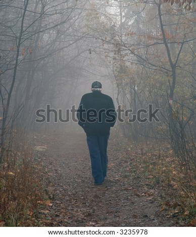 Old man walking in park