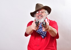 Old man wearing a patriotic bandana, floppy western hat has two pistols aimed at the camera.Viscous looking man with a mean snarl is pointing to guns at the camera.