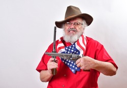 Old man wearing a patriotic bandana, floppy western hat has two pistolsViscous looking man with a mean snarl has two guns.