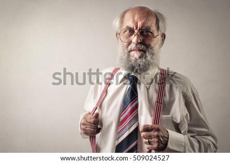 Old man wearing suspenders #509024527