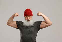 old man with a long beard on a grey background