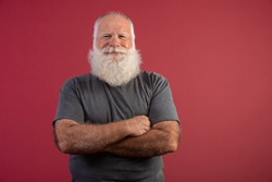 Old man with a long beard on a red background. Senior with full white beard. Old man with a long beard.