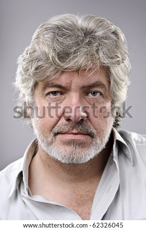 Old man with grey hair and wrinkled skin