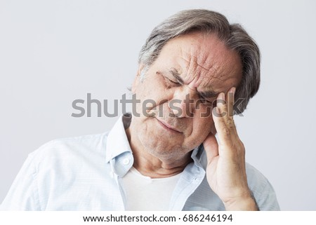 Old man with headache #686246194