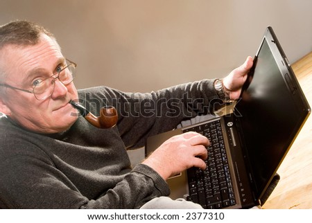 http://image.shutterstock.com/display_pic_with_logo/58832/58832,1167015153,1/stock-photo-old-man-working-on-the-laptop-computer-smoking-pipe-2377310.jpg