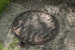 Old manhole cover in the hopper.