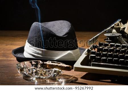 Old manual typewriter cigar and hat - stock photo