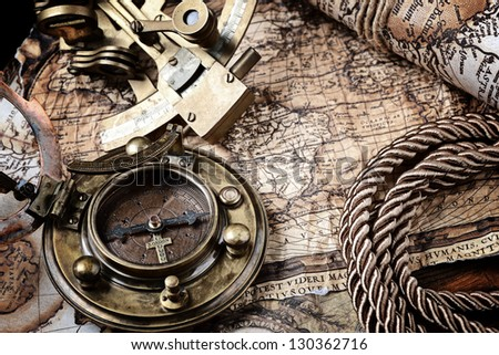 old map and cooper compass with cord - stock photo