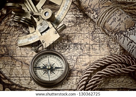 old map and cooper compass with cord