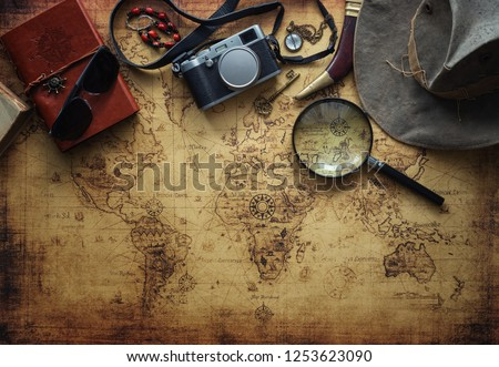 old map and vintage travel equipment / Travel concept #1253623090