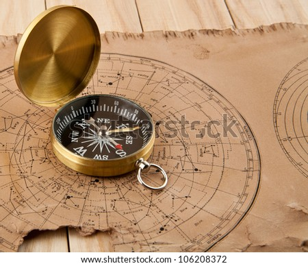 old maps and compass on a wooden table