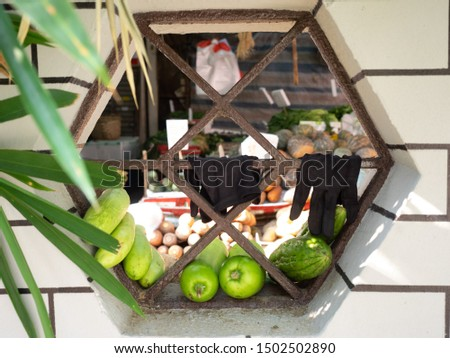 Old market sellers put the vegetable on the windows #1502502890