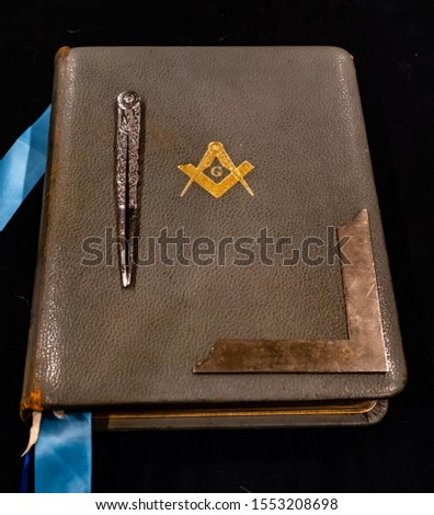 Old Masonic Bible, with working tools.