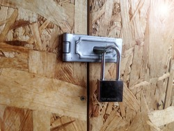 Old master key locked on ply wood door or box with copy space and have general text