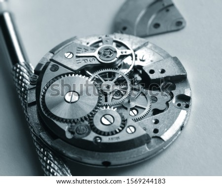 old mechanical watch mechanism, close up of small gear