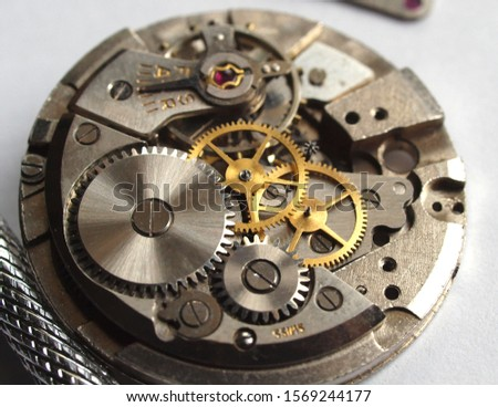 old mechanical watch mechanism, close up of small gears