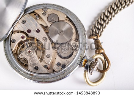 Old mechanism of an analog watch. Modes and mechanisms of the precision mechanism. Light background. #1453848890
