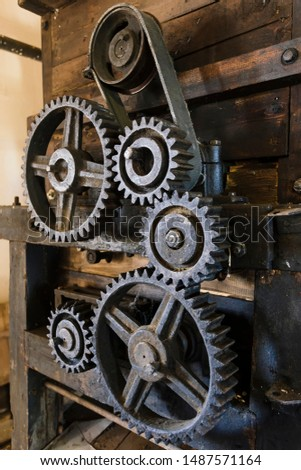 Old mechanism. Old gears and pulleys with belt. stock photo