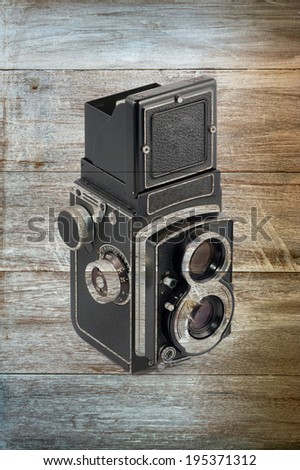 old Mediam format Camera in Wood background
