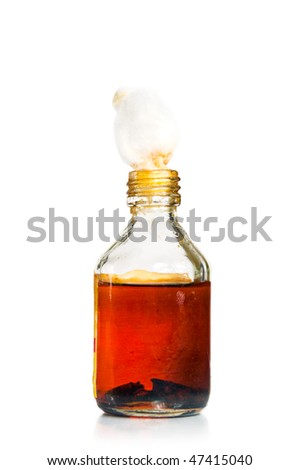 Old medical bottle with cotton swab, isolated on white