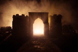 Old Medieval castle at night. Creative artwork decoration. Foggy background. Selective focus