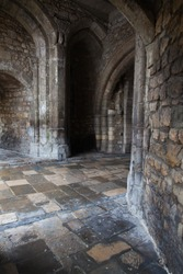 Old medieval castle stone corridors.