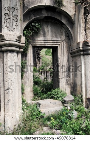 Old medieval church arc with saturated colors - stock photo