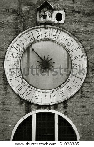 Old medieval clock with one hand, Venice, Italy
