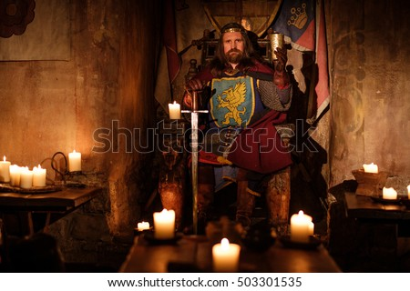 old medieval king on the throne ...