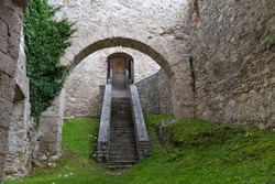 Old medieval ruined Gallenstein Castle. Arched vaults and stone staircase leading into the citadel. Municipality of Sankt Gallen,  Styria, Austria. Tourist landmark