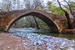 old medieval stony bridge over the small river