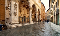 Old medieval streets of Siena, Tuscany, Italy. Siena architecture and landmark.