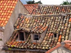 Old Mediterranean Tile Roof in Disrepair