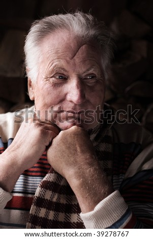 old men on dark background