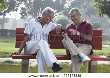 Old men reading an sms