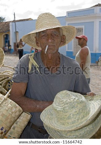 old men selling traditional hats on the street -trinidad