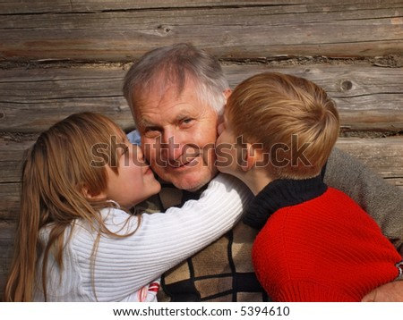 old men with children on background wooden wall
