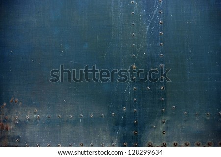 Old Metal Background with Bolt Heads. Grunge Metallic Background.