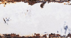 Old metal background with grunge texture and rusted vintage border, white peeling paint and brown grungy rust
