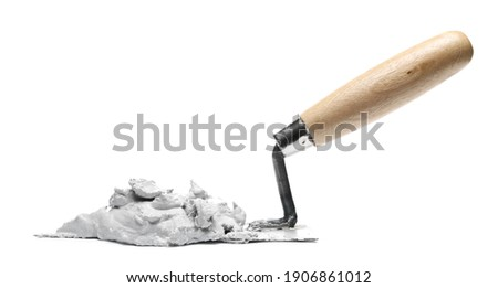 Old metal bricklaying trowel with wet cement, mortar isolated on white background Stockfoto ©