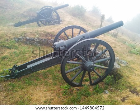 Old metal cannon weapons near Shipka, Bulgaria on foggy autumn day. Traditional military guns used mainly for fortress defense.  #1449804572
