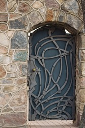old metal door in stone wall. High quality photo