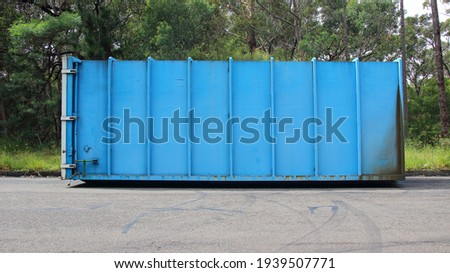 Old metal garbage compactors on the road Foto stock ©