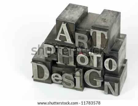 Old metal movable type compose the words: art, photo and design