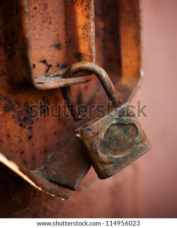 Old metal padlock - stock photo
