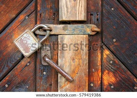 old metal padlock on a locked old wooden door/no entry shut out/ & Free photos Old metal padlock on a locked old wooden door/no entry ...