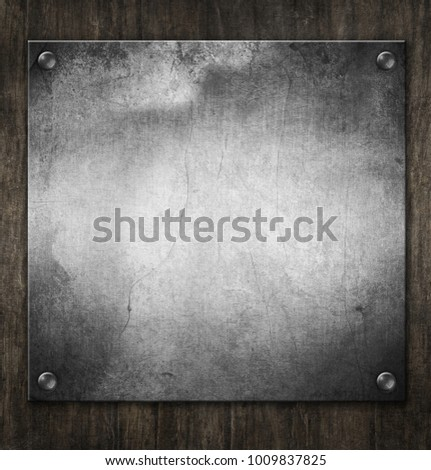 old metal plaque on wood...