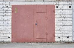 Old metal red garage door